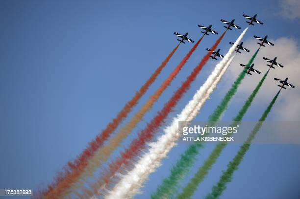 Members of the Italian Air Force the 'Frecce Tricolori' perform with their Aermacchi MB339 aircraft during the International Air Show at the...