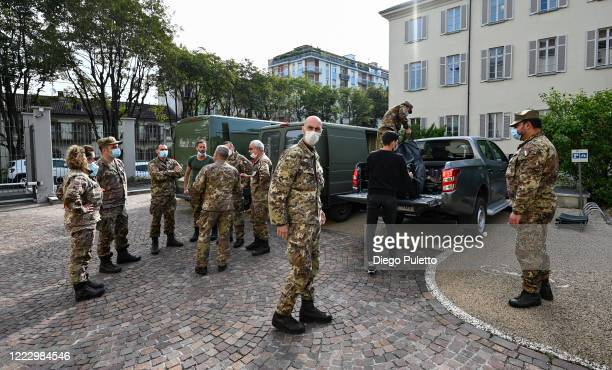 Members of the Italian army wearing face mask gather for the briefing prior to the disinfection of a nursing home on May 05, 2020 in Turin, Italy....