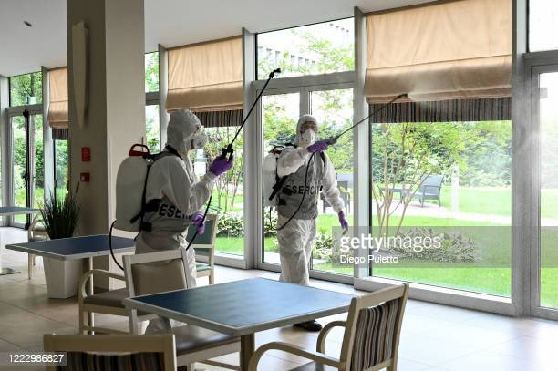Members of the Italian army wearing protective gear disinfect a nursing home on May 05, 2020 in Turin, Italy. Italy was the first country to impose a...