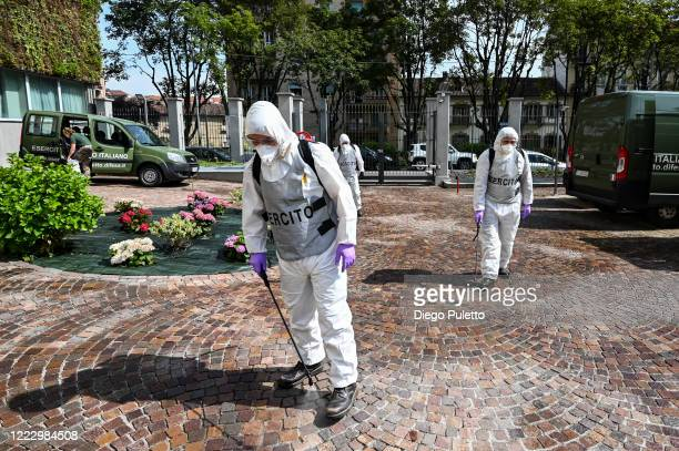 Members of the Italian army wearing protective gear disinfect the nursing home on May 05, 2020 in Turin, Italy. Italy was the first country to impose...