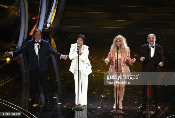 Members of the Italian band Ricchi e Poveri Angelo Sotgiu Angela Brambati Marina Occhiena and Franco Gatti perform on stage at the Ariston theatre...