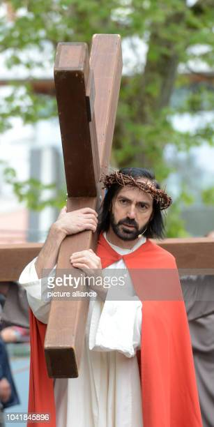 Members of the Italian Catholic parish San Martino reenact the Passion of Christ during the Good Friday procession in Stuttgart, Germany, 18 April...