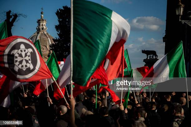 Members of the Italian far-right political party Casapound wave Italian flags during a demonstration against the mayor of Rome, on February 8, 2019....