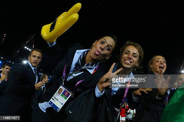 Members of the Italian Olympic team enter the stadium during the Opening Ceremony of the London 2012 Olympic Games at the Olympic Stadium on July 27...