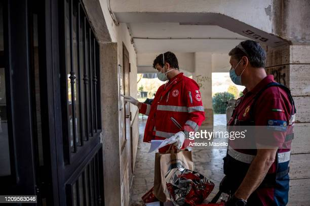 Members of the Italian Red Cross and the Italian Police association deliver food packages to people in difficulty during the Coronavirus emergency on...