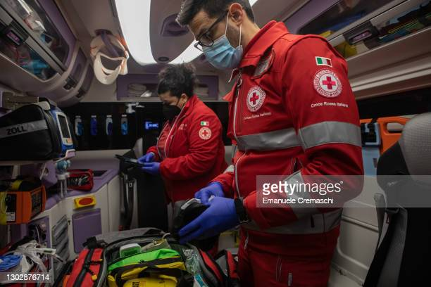 Members of the Italian Red Cross check medical equipment and prepare an ambulance before their night shift on February 18, 2021 in Bergamo, Italy....
