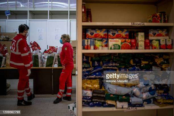 Members of the Italian Red Cross prepare food packages to be delivered to people in difficulty during the Coronavirus emergency on April 9 2020 in...