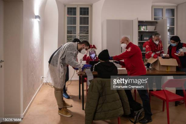 Members of the Italian Red Cross run tests on a man before allowing him to enter a protected community for homeless people on February 18, 2021 in...