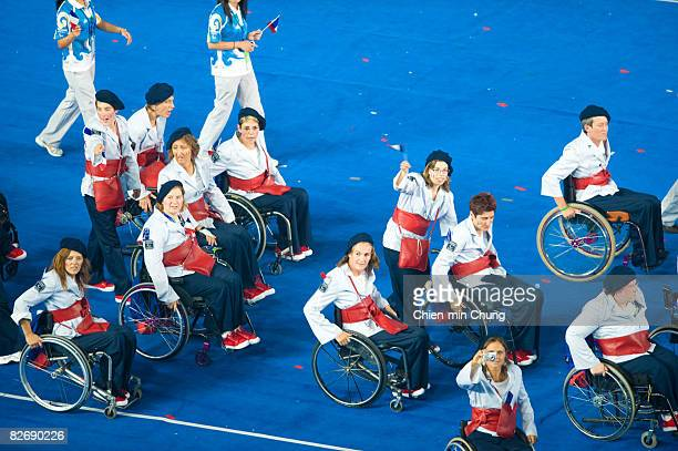 Members of the Italian team wave to the crowd during entrance of Athletes in the Opening Ceremony for the 2008 Paralympic Games at the National...