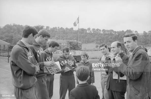 Members of the Italian World Cup football team sign autographs for fans 15th July 1966 Left to right Aristide Guarneri Giacinto Fachetti Romano Fogli...
