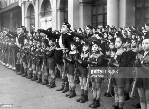 Members of the Italian youth fascist organisation the Balilla outside Rome railway station to greet the Prime Minister of Great Britain Neville...