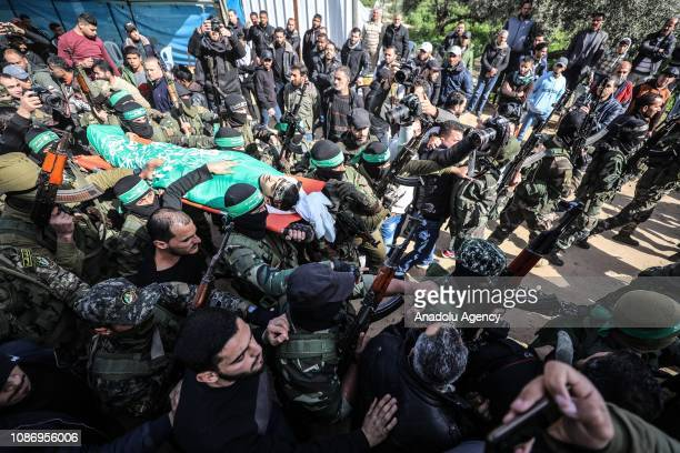 Members of the Izz adDin alQassam Brigades carry the dead body of Palestinian Mahmoud Abed alNabahin who was killed by Israeli army's air strike...