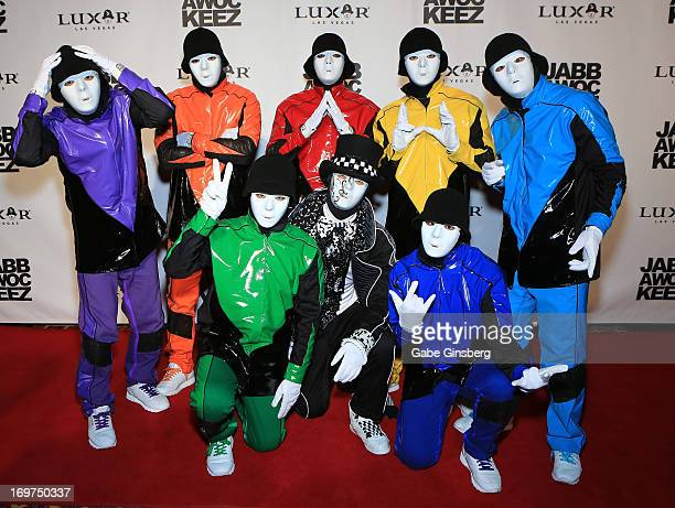 Members of the Jabbawockeez dance crew arrive at the grand opening of their show 'PRiSM' at the Luxor Resort Casino on May 31 2013 in Las Vegas Nevada