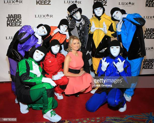 Members of the Jabbawockeez dance crew pose with model and television personality Holly Madison at the grand opening of their show PRiSM at the Luxor...
