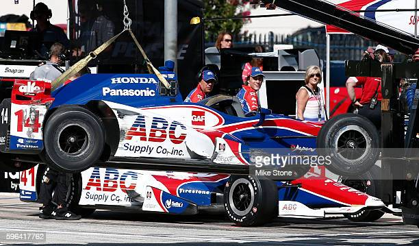 Members of the Jack Hawksworth ABC Supply AJ Foyt Racing Honda pit crew look on as the ABC Supply AJ Foyt Racing Honda driven by Takuma Sato is towed...