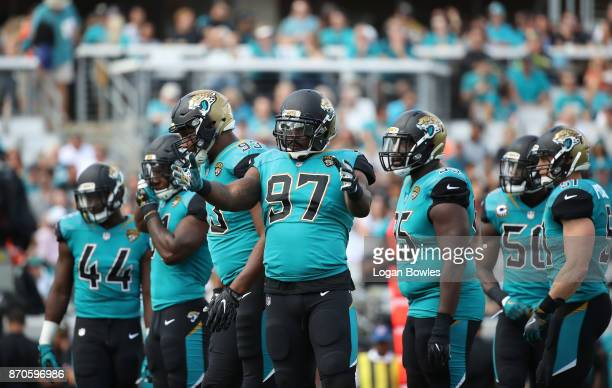 Members of the Jacksonville Jaguars defence wait on the field in the first half of their game against the Cincinnati Bengals at EverBank Field on...