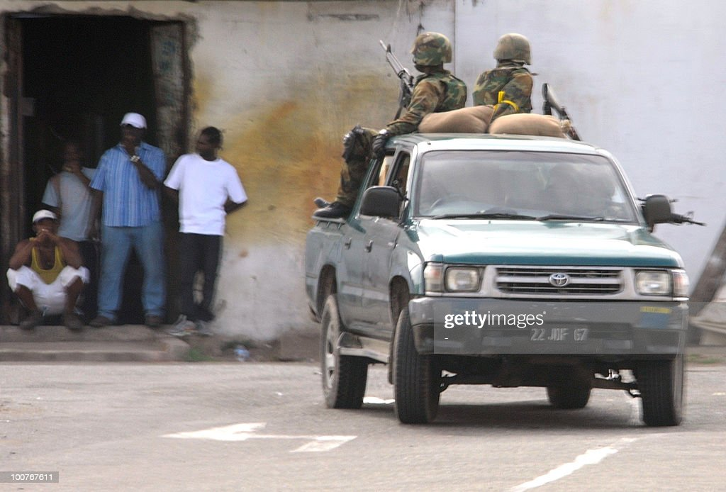 Members of the Jamaica Defence Force patrol a section of western Kingston in the Jamaican capital on May 24, 2010. Gun battles raging in the Jamaican capital have left more than 60 people dead, mostly civilians, hospital sources said Tuesday, as troops fanned out across the city hunting an alleged drug kingpin. Hundreds of troops and police have been deployed to hunt down Christopher 'Dudus' Coke, wanted in the United States on drug-trafficking charges, amid a week-long standoff with his loyal supporters.