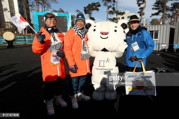 Members of the Japan and Colombia team pose with mascot Soohorang as they participate in a welcome ceremony ahead of the PyeongChang 2018 Winter...