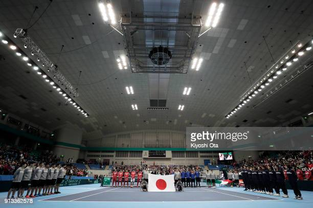 Members of the Japan Davis Cup team line up for the national anthem with the Italy Davis Cup team at the opening ceremony during day one of the Davis...