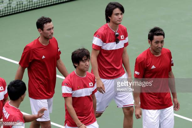Members of the Japan Davis Cup team Yosuke Watanuki Ben McLachlan Yoshihito Nishioka Taro Daniel and Yasutaka Uchiyama celebrate the team's 30...