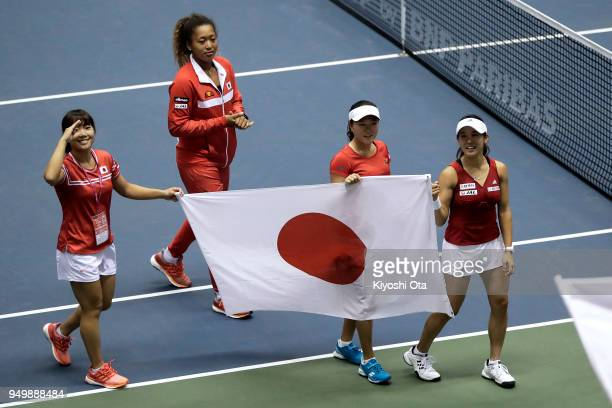 Members of the Japan Fed Cup team Kurumi Nara Naomi Osaka Makoto Ninomiya and Miyu Kato celebrate the team's 32 victory against Great Britain during...