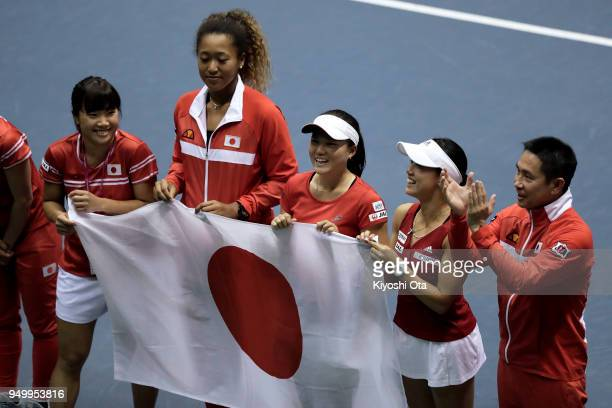 Members of the Japan Fed Cup team Kurumi Nara Naomi Osaka Makoto Ninomiya Miyu Kato and team captain Toshihisa Tsuchihashi celebrate the team's 32...