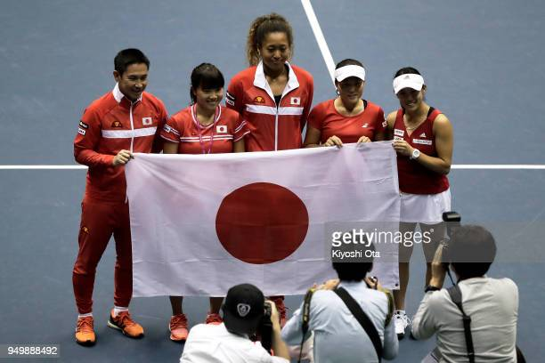 Members of the Japan Fed Cup team team captain Toshihisa Tsuchihashi Kurumi Nara Naomi Osaka Makoto Ninomiya and Miyu Kato pose for photographs as...