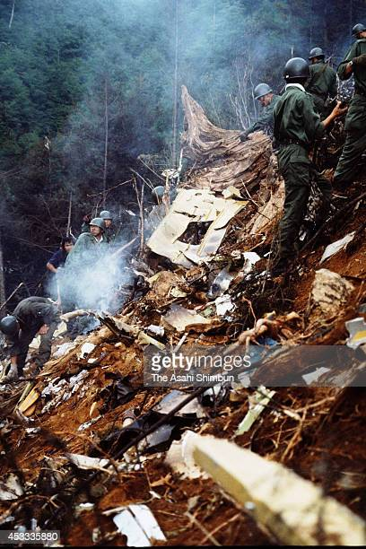 Members of the Japan Ground Self-Defense Force in a rescue operation at the crash site at the ridge of Mount Osutaka on August 13, 1985 in Ueno,...
