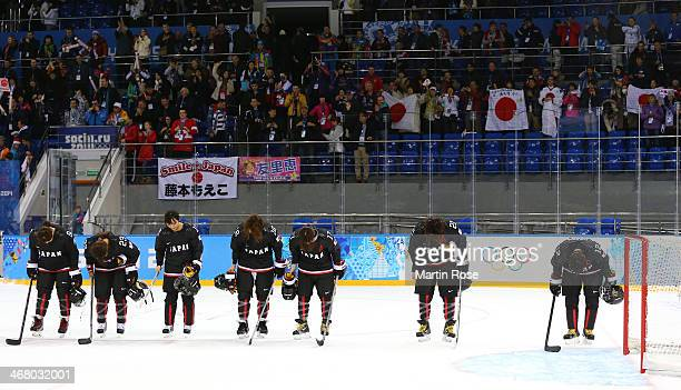 Members of the Japan ice hockey team bow after the Women's Ice Hockey Preliminary Round Group B Game on day two of the Sochi 2014 Winter Olympics at...