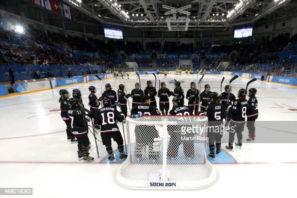Members of the Japan ice hockey team form a huddle prior to the Women's Ice Hockey Preliminary Round Group B Game on day two of the Sochi 2014 Winter...