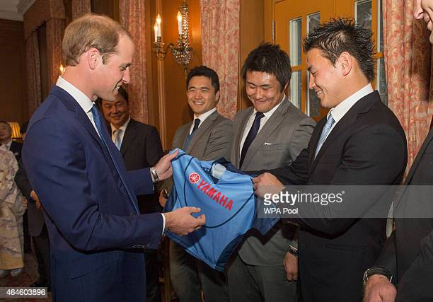 Members of the Japan Rugby World Cup Squad meet Prince William Duke of Cambridge and present him with a shirt for Prince George at a reception at...