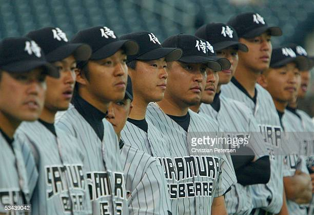 Members of the Japan Samurai Bears line up for the National Anthem before the Golden Baseball League game against the Surprise Fighting Falcons May...