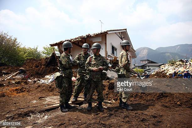 Members of the Japan SelfDefense Force search the area where houses were destroyed by a landslide following an earthquake on April 19 2016 in...