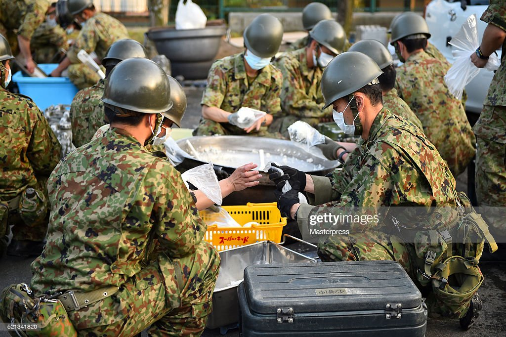 Members of the Japan Self-Defense Forces make rice balls at the soup-run operated at the evacuation center a day after the 2016 Kumamoto Earthquake at the Mashiki Town Hall on April 15, 2016 in Mashiki, Kumamoto, Japan. As of April 15 morning, at least nine people died in the powerful earthquake with a preliminary magnitude of 6.4 that struck Kumamoto Prefecture on April 14, 2016.