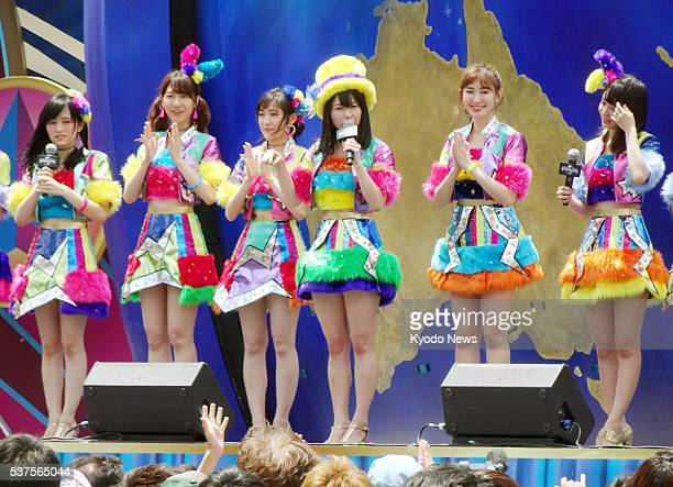 Members of the Japanese allgirl pop group AKB48 take part in a promotional event at Universal Studios Japan in Osaka western Japan on June 2 2016 USJ...