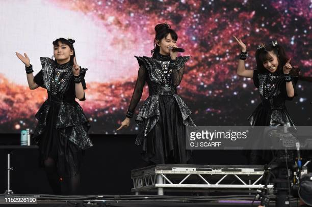 Members of the Japanese band 'Babymetal' perform on The Other Stage at the Glastonbury Festival of Music and Performing Arts on Worthy Farm near the...