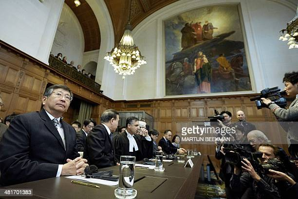Members of the Japanese delegation, Koji Tsuruoka, Masaru Tsuji, Payam Akhavan, Alan Boyle and Yuji Iwasawa wait prior to the verdict in the case...