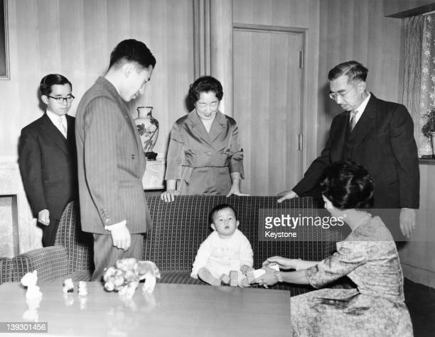 Members of the Japanese Imperial Family are photographed for their New Year's Day picture at the Imperial Palace in Tokyo 1st January 1961 Left to...