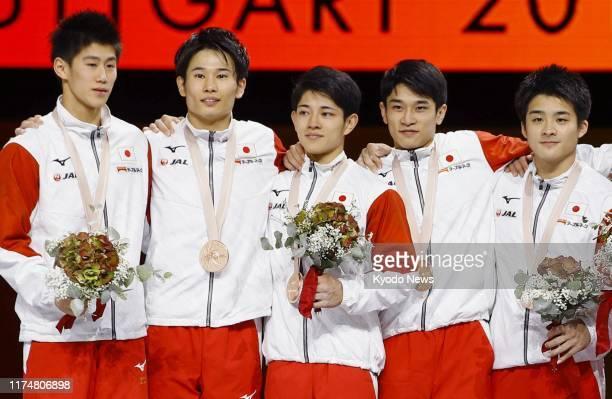Members of the Japanese men's gymnastics team -- Daiki Hashimoto, Kazuma Kaya, Kakeru Tanigawa, Wataru Tanigawa and Yuya Kamoto -- pose for a photo...