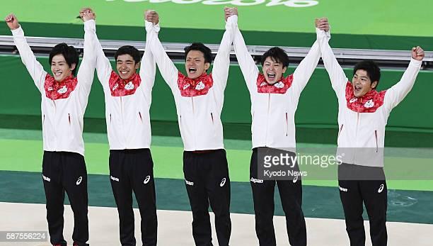 Members of the Japanese men's gymnastics team Ryohei Kato Kenzo Shirai Yusuke Tanaka Kohei Uchimura and Koji Yamamuro are bursting with joy on the...