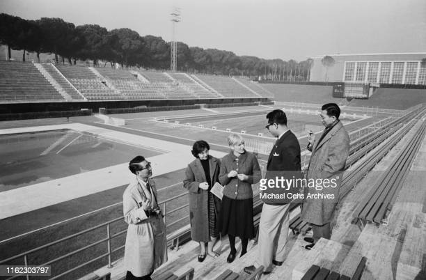 Members of the Japanese Olympic Committee and CONI interpreters visit the Stadio Olimpico del NUoto, venue of the 1960 Summer Olympics located within...