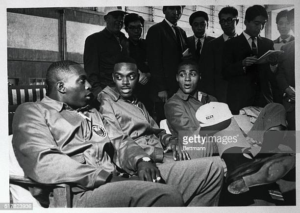 Members of the Japanese press interview three US track stars Bob Hayes Ralph Boston and Henry Carr shortly after the first contingent of the US...
