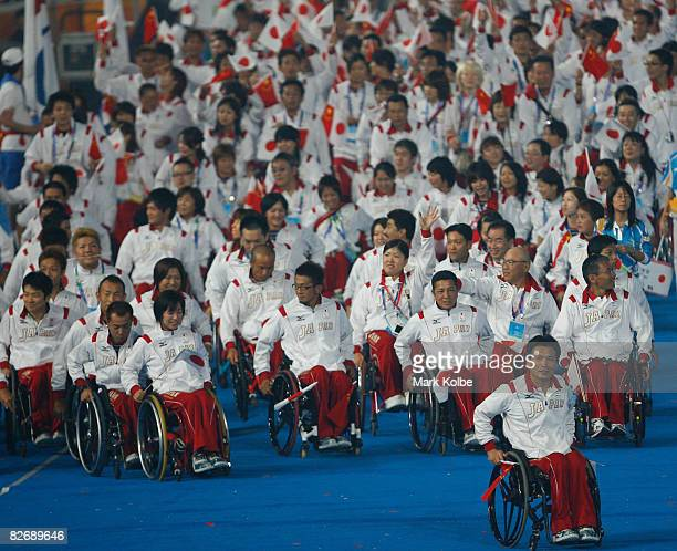 Members of the Japanese team enjoy the atmosphere during entrance of Athletes in the Opening Ceremony for the 2008 Paralympic Games at the National...