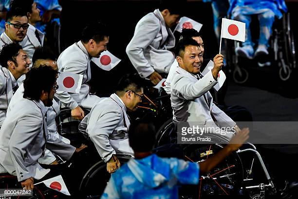 Members of the Japanese team enter the stadium during the Opening Ceremony of the Rio 2016 Paralympic Games at Maracana Stadium on September 7, 2016...
