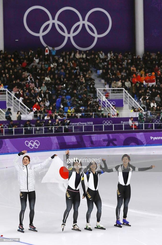 Members of the Japanese women's speed skating team -- (from L) Ayaka Kikuchi, Ayano Sato, Nana Takagi, Miho Takagi -- celebrate after winning the pursuit gold medal in Gangneung, South Korea, at the Pyeongchang Winter Olympics on Feb. 21, 2018. ==Kyodo