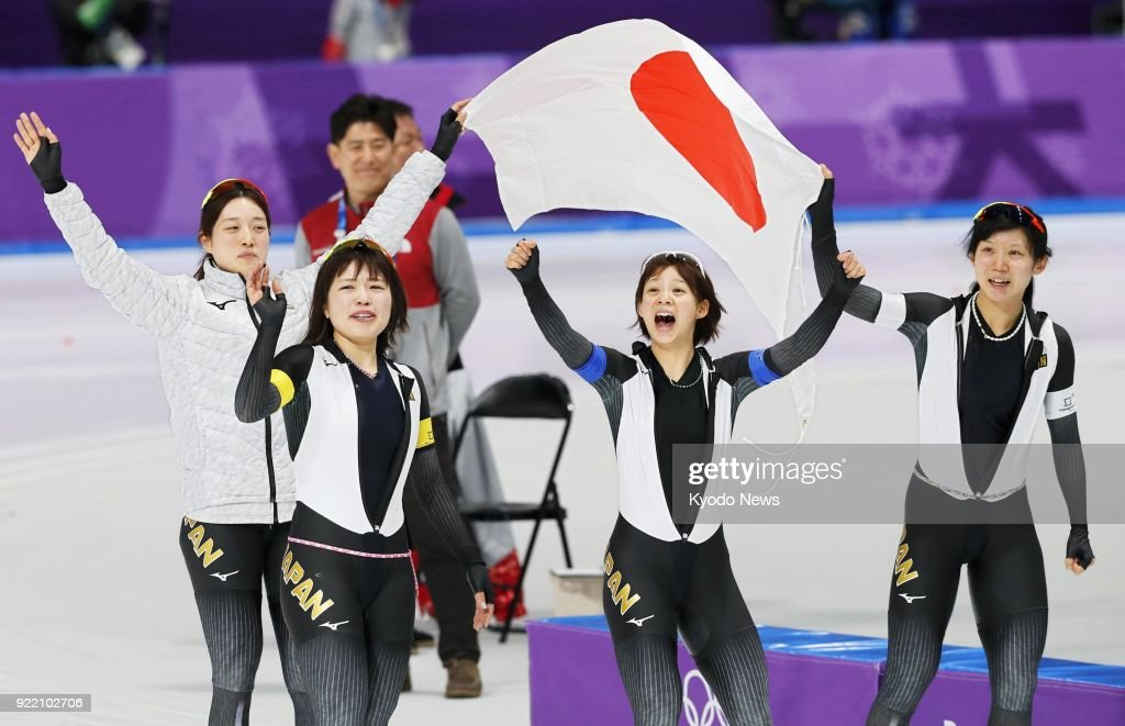 Members of the Japanese women's speed skating team -- (from L) Ayaka Kikuchi, Ayano Sato, Nana Takagi, Miho Takagi -- celebrate after winning the pursuit gold medal in Gangneung, South Korea, at the Pyeongchang Winter Olympics on Feb. 21, 2018. ==Kyodo