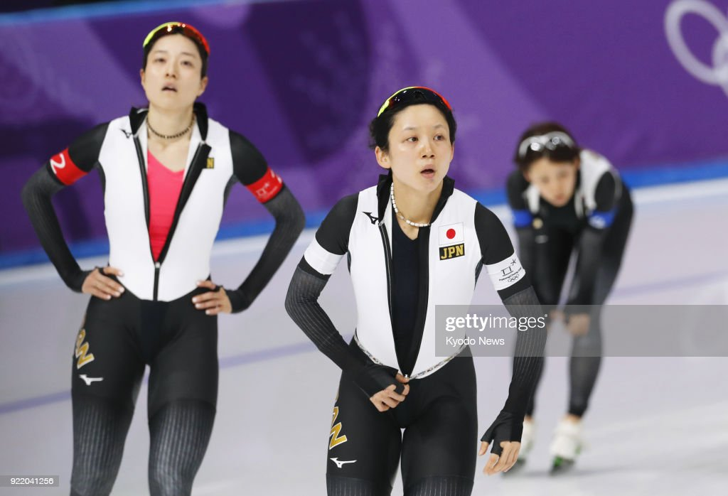 Members of the Japanese women's speed skating team -- (from L) Ayaka Kikuchi, Miho Takagi, Nana Takagi -- react after defeating Canada in the pursuit semifinals in Gangneung, South Korea, at the Pyeongchang Winter Olympics on Feb. 21, 2018. ==Kyodo