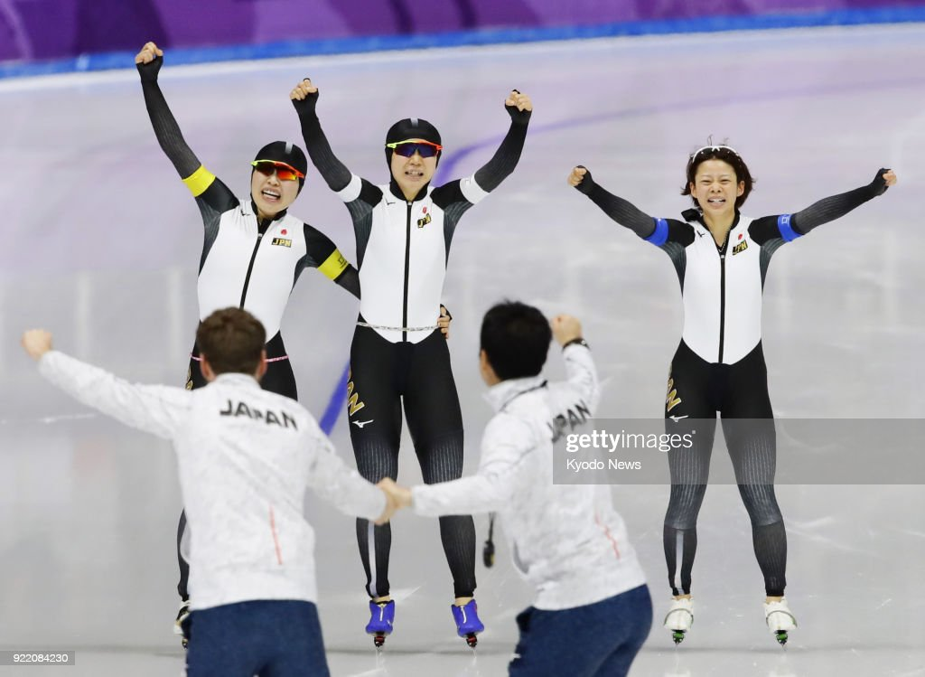 Members of the Japanese women's speed skating team -- (from L) Ayano Sato, Miho Takagi, Nana Takagi -- celebrate after winning the pursuit gold medal in Gangneung, South Korea, at the Pyeongchang Winter Olympics on Feb. 21, 2018. ==Kyodo