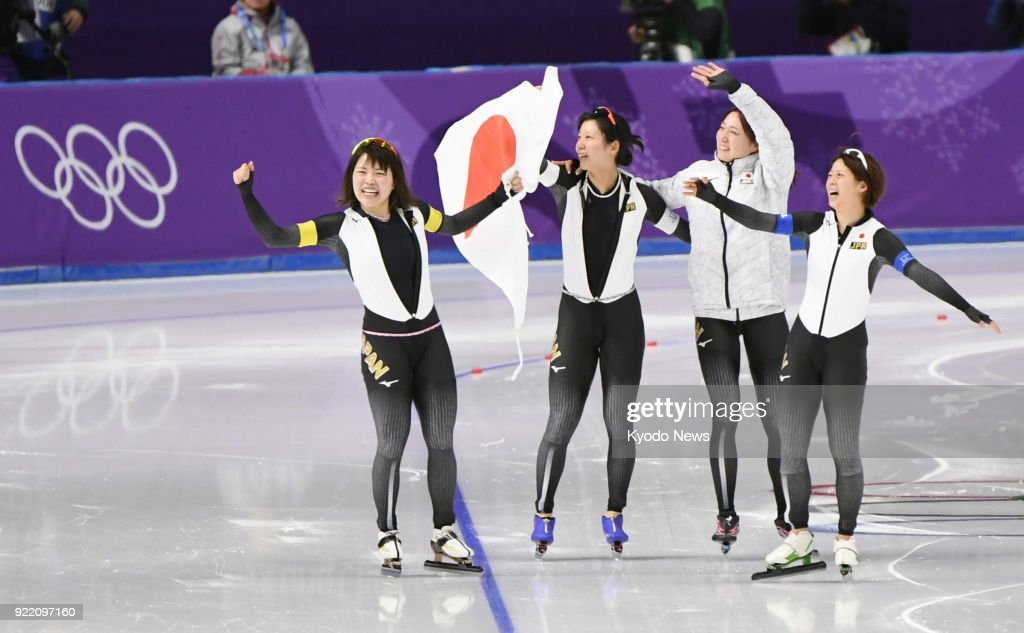 Members of the Japanese women's speed skating team -- (from L) Ayano Sato, Miho Takagi, Ayaka Kikuchi, Nana Takagi -- celebrate after winning the pursuit gold medal in Gangneung, South Korea, at the Pyeongchang Winter Olympics on Feb. 21, 2018. ==Kyodo