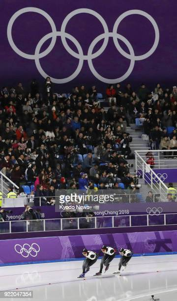 Members of the Japanese women's speed skating team compete against Canada in the pursuit semifinals in Gangneung South Korea at the Pyeongchang...
